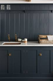 top hardware styles to pair with your shaker cabinets navy shaker cabinets marble counter top brass latch hardware
