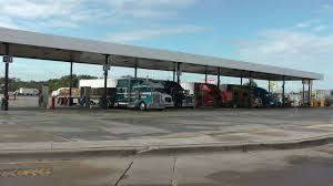 Over the road trucks fueling at ta travel center truck stop in