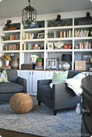 i like the built in bookcases here and the color scheme with white