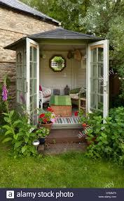 Summer House In Garden - small summerhouse in english garden stock photo royalty free