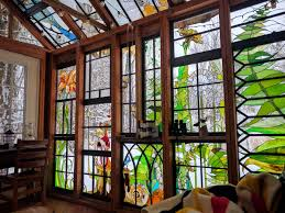 a stained glass cabin hidden in the woods by neile cooper colossal