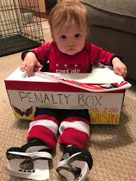this baby dressed up as tom wilson in a penalty box for halloween