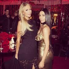 paris hilton and kim kardashian west reunite at christmas party