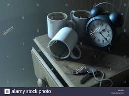 a real life concept scene showing a vintage clock on a bed side
