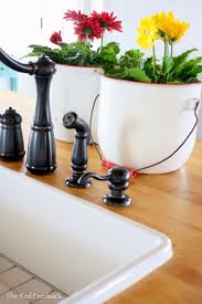 the red feedsack update on butcher block countertops i have oiled around my faucet and sink more frequently as i want to be sure that it repels water a lot of readers have asked if i have any water damage