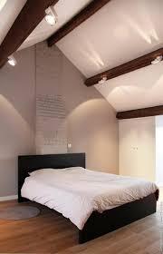 chambre poutre apparente chambre moderne aux tons naturels avec plafond poutres apparentes et