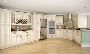 kitchens with white appliances and dark cabinets cream colored