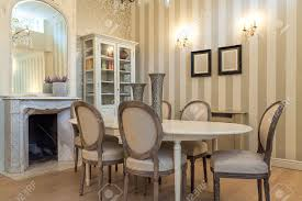 Mansion Dining Room by Vintage Mansion A Beige Dining Table In A Classy Interior Stock