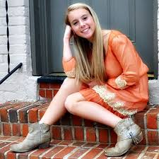 poses on stairs wearing dress and boots she has a southern