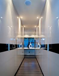 entrance hall with a modern decor wall white mica wood flooring