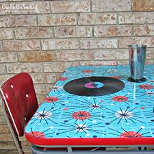 how to refinish a table with fabric and resin