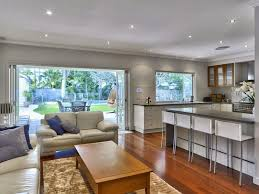 queenslander open plan kitchen on ground floor with garden pool