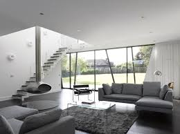 define livingroom angular lines and greyscale color define this abode