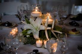 themed wedding centerpieces with coral ornaments and candles