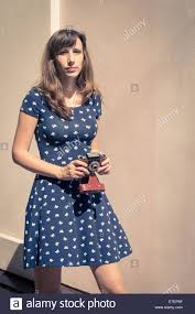 hipster girl young hipster girl walking with old film camera stock photo