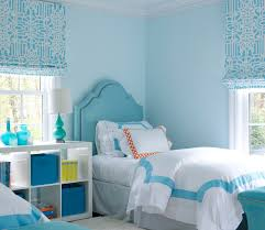 blue girls bedroom with turquoise nailhead headboards and blue
