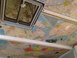 mod podge your pop up camper ceiling with old maps camper pop