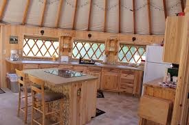 yurt homes comfortable leather couches and a big flat screen tv