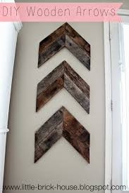 wood decor on wall brick house reclaimed wood project diy wooden arrows