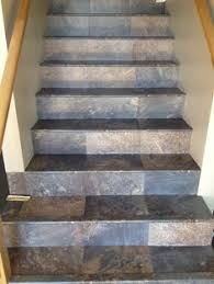 luxury vinyl tile installed with custom insert stair nosings