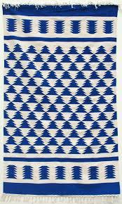 royal blue and off white aztec design shuttlewoven dhurrie rug