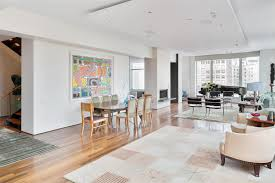 brown wooden floor connected by white wall theme and beige carpet