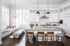 architectural digest krista home the kitchen serves as an additional entertaining space barstools from room board pull up to an island designed by rachel eve design