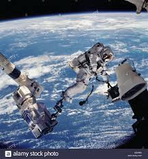 space shuttle astronaut astronaut on extended robotic arm space shuttle stock photo
