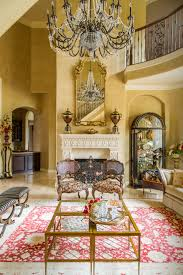 guests are welcomed by a grand staircase into this formal living