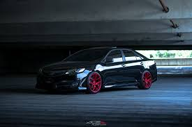 stanced toyota camry a camry that stands out black paint and red ace alloy rims