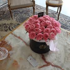roses in the hatbox flowers delivery black orchid flower boutique