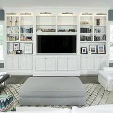 built in living room cabinets feminine chicago condo full tour shelving entertainment and storage