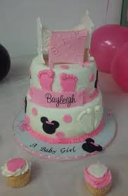 2 tier minnie mouse w baby crib and blanket baby shower cake on