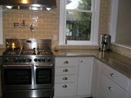 decorating white kitchen cabinets with corian countertop and gas