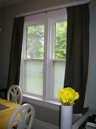 classic white wooden window frame with nice glass sliding blind