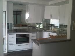 mirror backsplash in kitchen glass without border shower doors glass railing kitchen