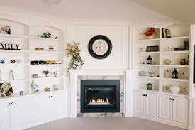 fireplace mantle and custom living room built ins
