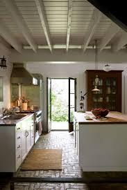 rustic stone flooring exposed ceiling beams maroon island with