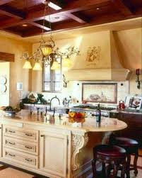 tuscan kitchen with gold chandelier over island with white
