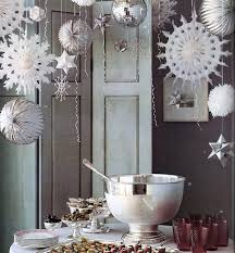 let it snow 15 ways to decorate with paper snowflakes brit co