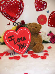 valentines day teddy valentines day teddy with hearts and flowers and i stock