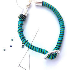 thread cord bracelet images Easy and fast way to make thread wrapped bracelets the beading jpg