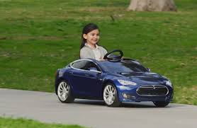 toy sla model s for kids has electric motor working headlights