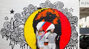 city of sydney plans to remove red tape for street artists and artist sofia fitzpatrick and blender gallery owner tali udovich with a mural of
