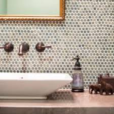 photos  hgtv with penny round tile accent wall in powder room from photoshgtvcom