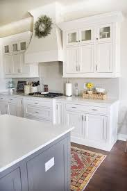 the backsplash is a light gray subway tile color is called pumice