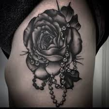 traditional rose tattoo with name by jon poulson tattoos on your