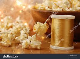 christmas still life popcorn being threaded stock photo 85489624