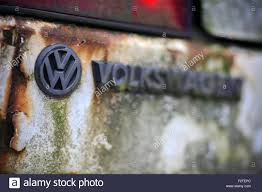 auto junkyard germany seen on an old volkswagen golf a weathered logo is visible at a