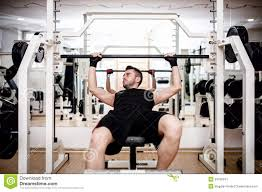 man working out at gym resting at bench press stock photo image